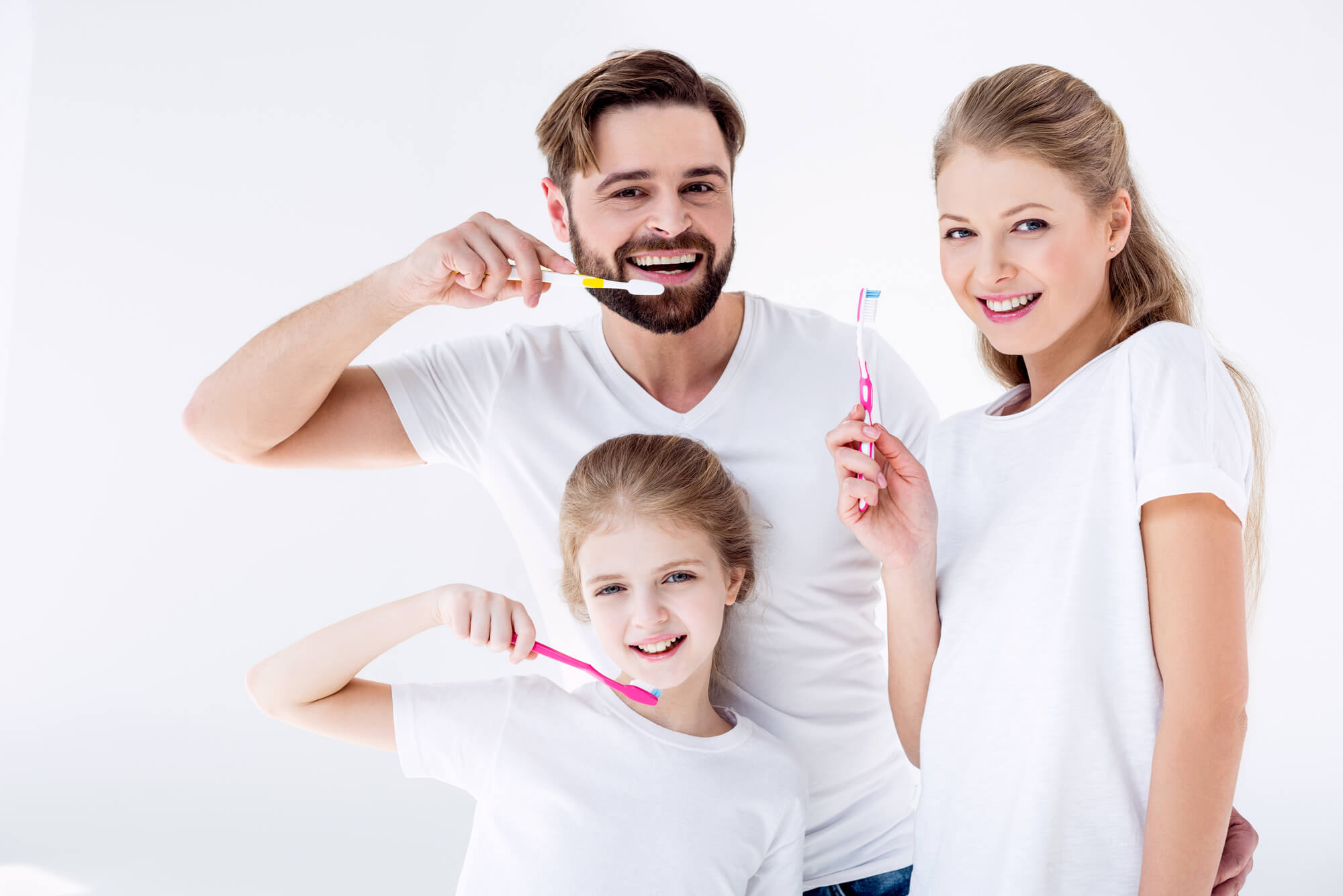 family brushing their teeth together as advised by Lake Worth family dentistry