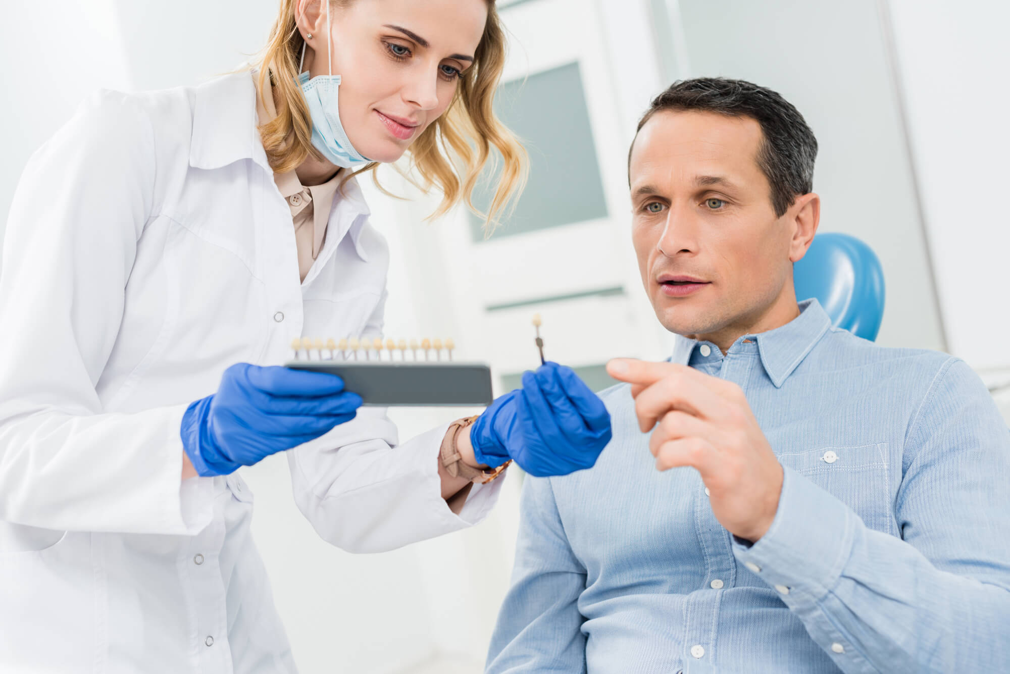 patient choosing the right teeth for his Dental Implants in West Palm Beach