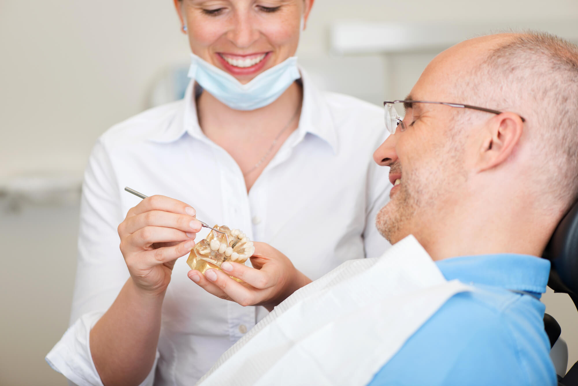 dental professional explaining about Dental Implants in West Palm Beach