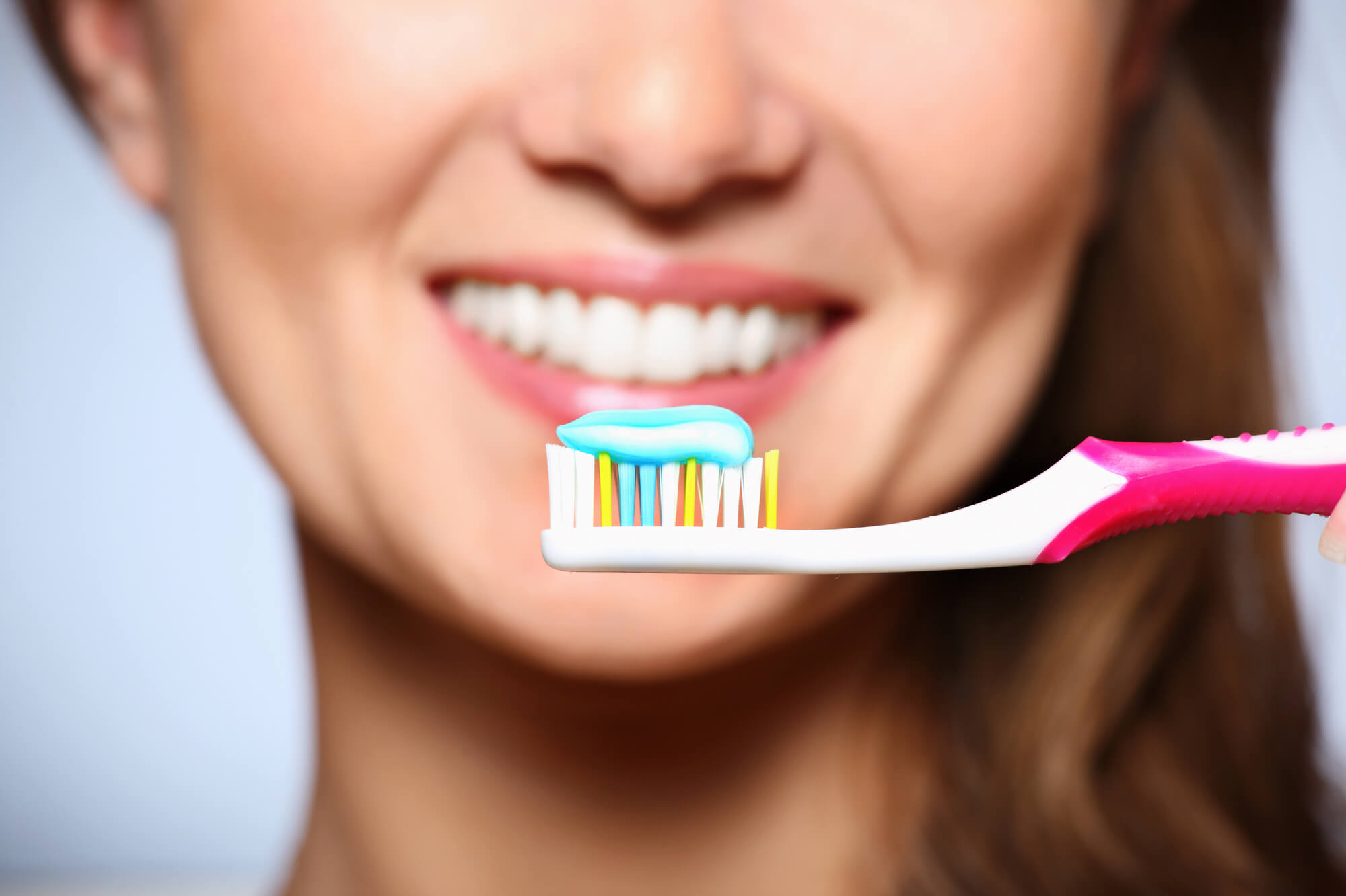 woman showing a fresh-looking smile as a result of Lake Worth family dentistry